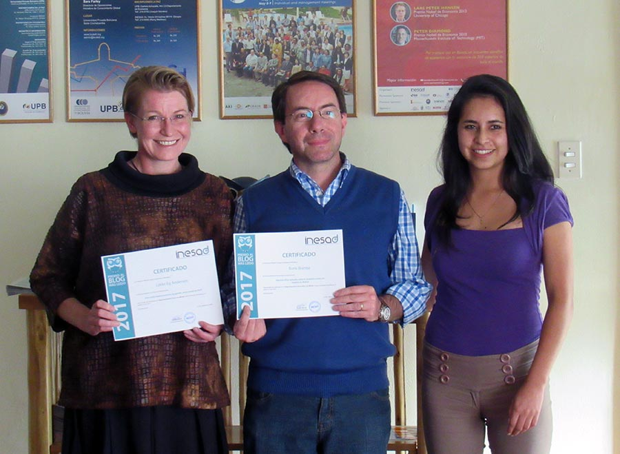 Lykke and Boris receiving their certificates for most read INESAD blogs (in English and Spanish, respectively) published in 2017.